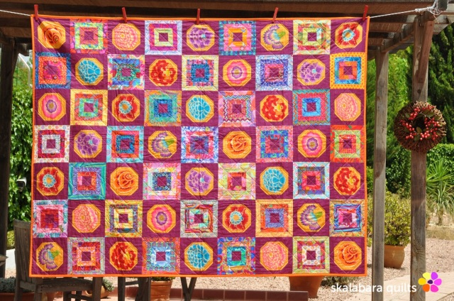 magenta and gold flowers quilt - skalabara quilts