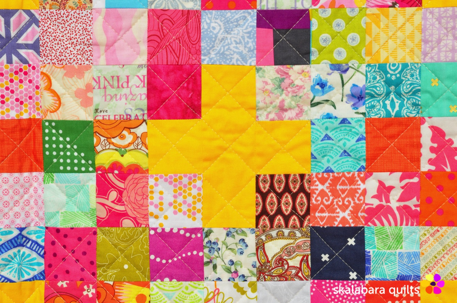 scrappy checkered quilt with crosses detail - skalabara quilts