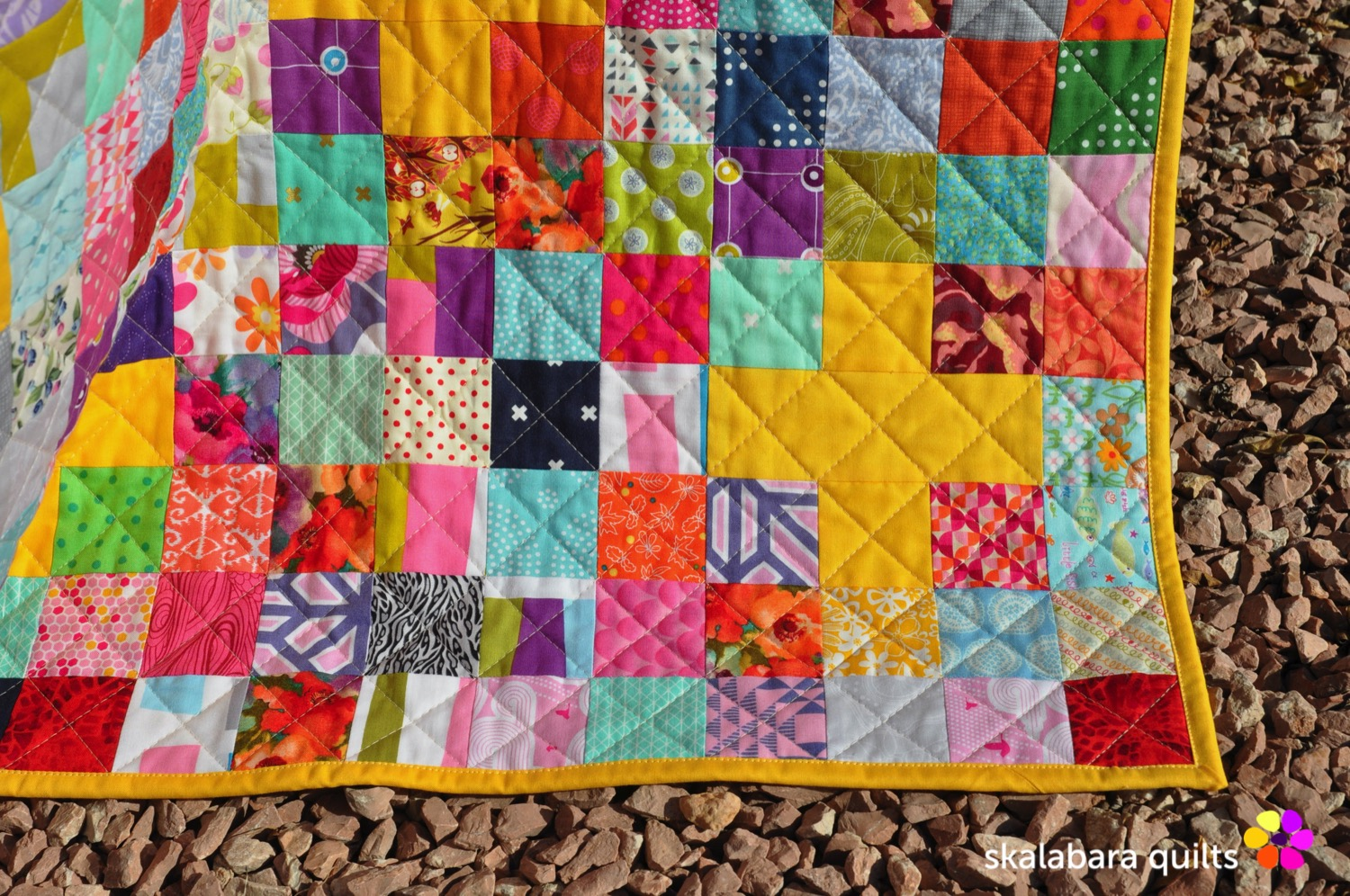 scrappy checkered quilt with crosses quilting - skalabara quilts