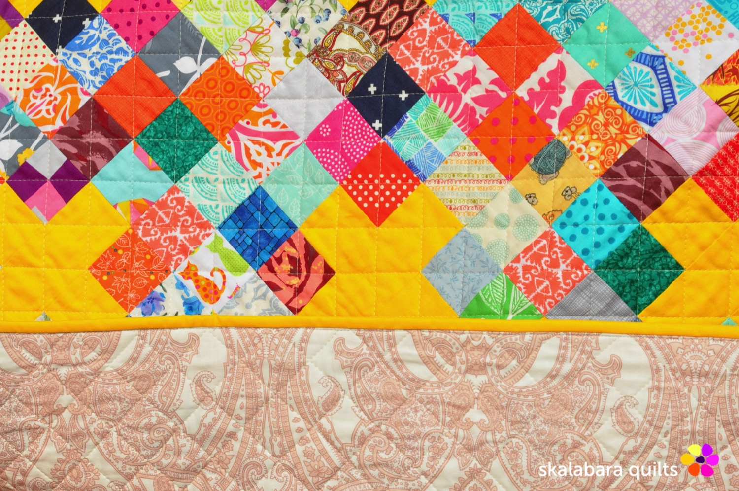 scrappy checkered quilt with crosses binding - skalabara quilts