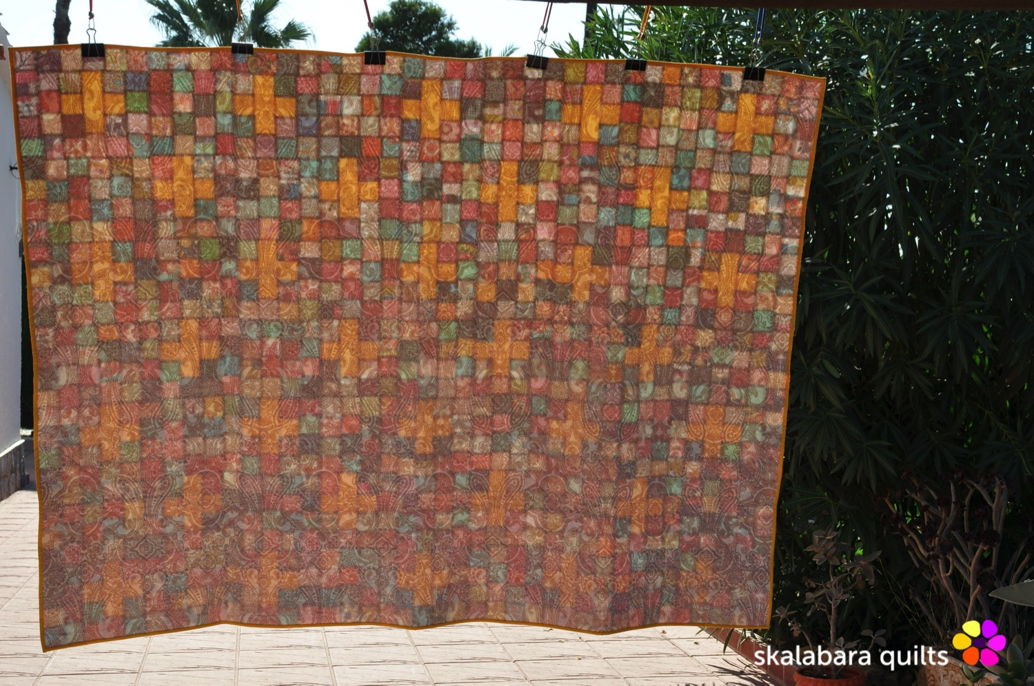 scrappy checkered quilt with crosses back - skalabara quilts