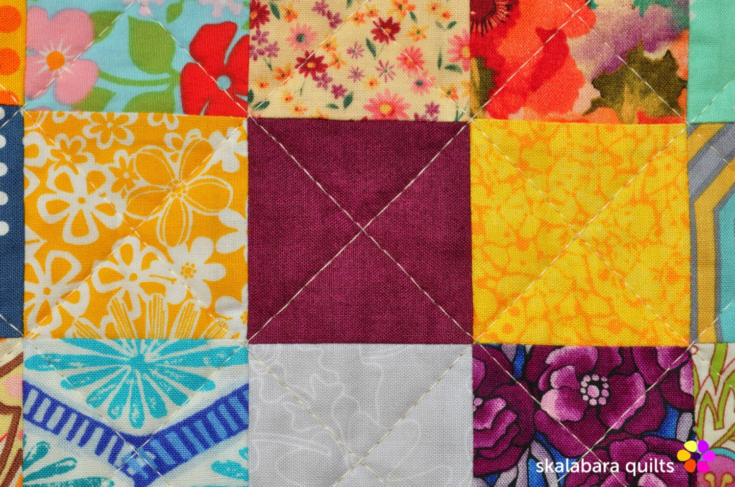 scrappy checkered quilt with crosses stitch length - skalabara quilts