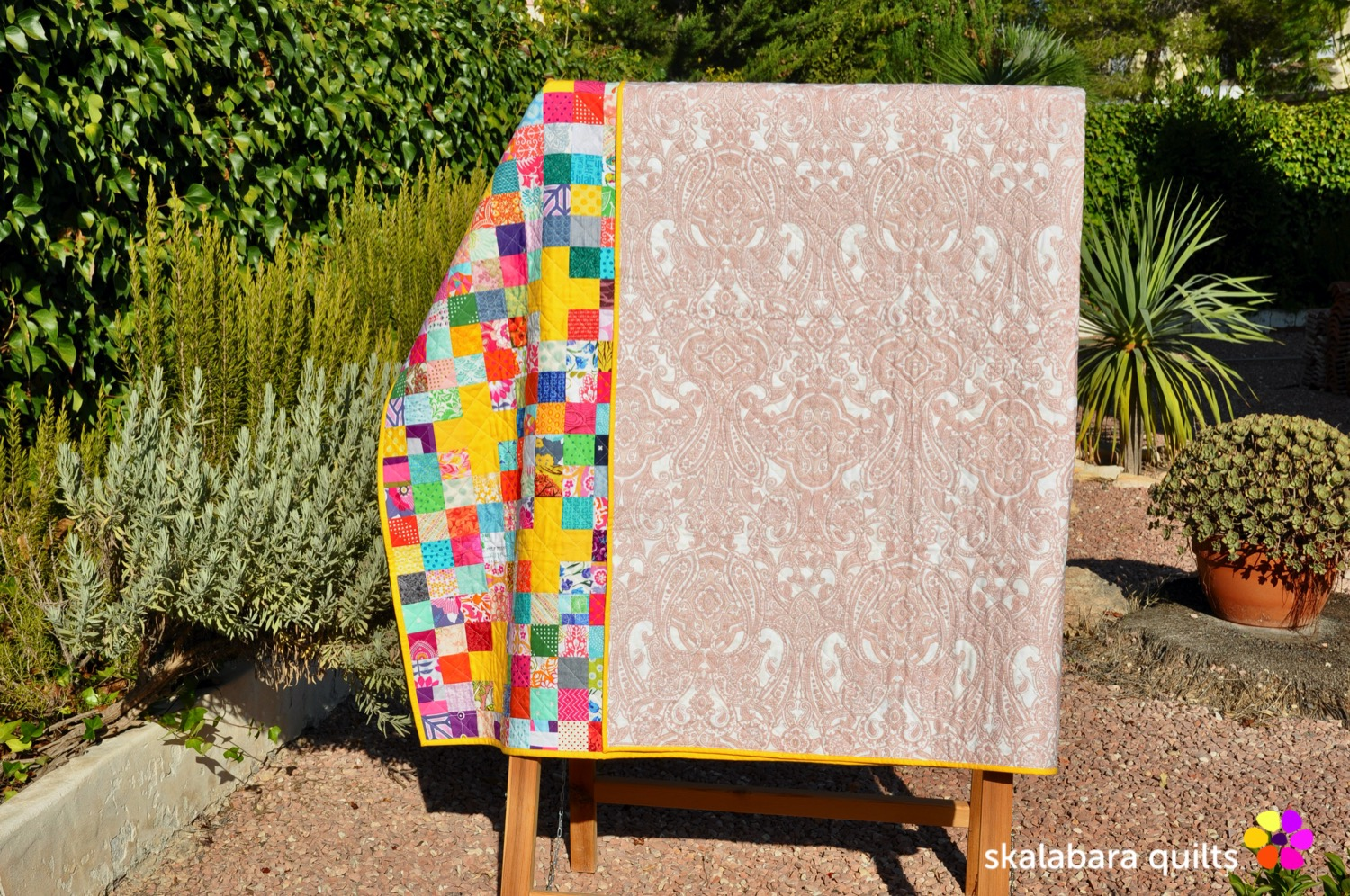 scrappy checkered quilt with crosses backing - skalabara quilts