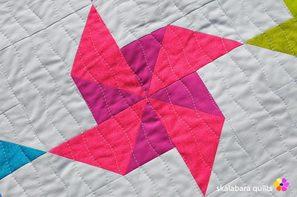 spinning windmill quilt throw quilting detail - skalabara quilts